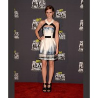 Emma's mini dress might be cute, but the cut-out detail gives it a hint of edgy appeal. Source: Jason Merritt/Getty via Popsugar. http://www.fabsugar.com/Emma-Watson-Best-Red-Carpet-Looks-34550459#photo-34550475