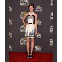 Emma's mini dress might be cute, but the cut-out detail gives it a hint of edgy appeal. Source: Jason Merritt/Getty via Popsugar. http://www.fabsugar.com/Emma-Watson-Best-Red-Carpet-Looks-34550459#photo-34550475
