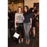 "Ilana Moses (left) at Dannijo New York Fashion Week presentation wearing Les Prairies de Paris ""I wish Morgan Freeman Narrated my life"" t-shirt, Ines Marechal leather pants, Dannijo necklace, Dries Van Noten shoes, Christopher Kane clutch and Jonathan Sim"