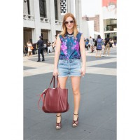 At the Lincoln Centre for Steven Alan's New York Fashion Week presentation wearing Thierry Lasry Sexxy sunglasses, Calla silk sleeveless top, Dannijo necklace, Mother denim cut offs, Dries Van Noten wedges, Celine handbag and Grace Zebra print iPhone cove