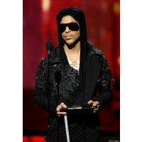 He's still got it. Prince. In Prince-wear. Via huffingtonpost.com
