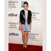 Toughen up a feminine look with a black moto jacket, like Emma did here at the Tribeca Film Festival. Source: Andy Kropa/Getty via Popsugar. http://www.fabsugar.com/Emma-Watson-Best-Red-Carpet-Looks-34550459#photo-34550483