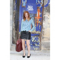 Between appointments in Le Marais during Paris fashion week wearing Carven Lace top, Grace leather skirt, Charlotte Olympia velvet kitty loafers and Celine bag. Photo credit: Alex Bock