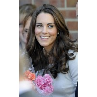 Kate's trademark long curls. Image via http://www.curlformers.com/blog/latest-news/creating-casual-curls-couture-twist/attachment/kate-middleton-951324582/