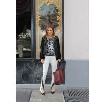 In a Parisian laneway wearing MSGM pants, Grace zebra print silk t-shirt, Jonathan Simkhai leather bomber jacket, Celine heels and Celine bag. Photo credit: Alex Bock