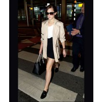 Emma rocks a monochrome ensemble, topped with a beige trench, while in transit — if only we could all look this good when travelling! Source: Celebmafia. http://celebmafia.com/emma-watson-heathrow-airport-london-march-2014-77523/