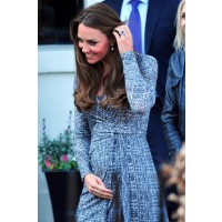 Kate Middleton in wrap dress. Image via http://www.wetpaint.com/network/gallery/pregnant-kate-middletons-growing-baby-bump-from-every-angle-photos#1