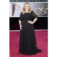 Adele outfit #1. Adele is back to her standard black dress with sparkles look after a brief floral soujourn at the Grammys. Source: http://oscar.go.com/red-carpet/photos/85th/red-carpet/womens-fashion-20