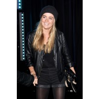 Showing of her grunge side in beanie and leather shorts. http://www.bornrich.com/cressida-bonas.html
