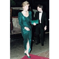 Wearing Catherine Walker in 1995. http://www.marieclaire.co.uk/celebrity/pictures/30982/42/princess-diana-s-iconic-style-moments-fashion-pics-marie-claire-uk.html#index=23