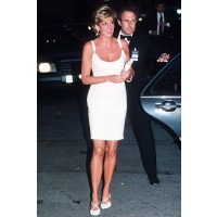 In figure revealing white Versace at a charity event in Italy. This look was recreated in the movie and worn by Naomi Watts. http://www.marieclaire.co.uk/celebrity/pictures/30982/42/princess-diana-s-iconic-style-moments-fashion-pics-marie-claire-uk.html#i