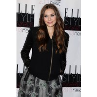 Elizabeth Olsen rocks a leather and satin ensemble at New York Fashion week. http://guestofaguest.com/new-york/fashion-week/nyfw-2013-15-front-row-front-runners&slide=8
