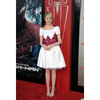 In Chanel at the Amazing Spider-Man premier. http://i.huffpost.com/gen/667547/thumbs/o-EMMA-STONE-CHANEL-570.jpg?4