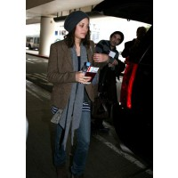 Marion Cotillard touches down in LAX in 2009 en-route to the Academy Awards. posh24.com