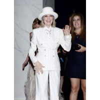 Diane Keaton in a white, stripped pantsuit at the White House Correspondents' Association Dinner in 2012. http://www.washingtonpost.com/lifestyle/style/diane-keatons-definitive-style/2012/04/30/gIQArvxPsT_gallery.html