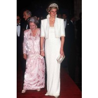 "Dubbed the ""Elvis Dress"" by the press due to the high collar, pearl encrusted bolero, Diana wore this Catherine Walker creation to in Hong Kong in 1989. http://www.marieclaire.co.uk/celebrity/pictures/30982/42/princess-diana-s-iconic-style-moments-fashion"