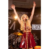 Performing in LA in July in an ox blood PVC skater skirt and crop top. http://www.marieclaire.co.uk/news/celebrity/543281/rita-ora-blue-ivy-s-wardrobe-is-bigger-than-beyonc-and-jay-z-s.html#index=1