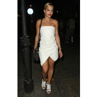 Leaving a London restaurant in July. Ora is wearing Shakuhachi Spring 2013 White Origami Bustier Dress and Damir Doma Shoes. http://www.digitalspy.co.uk/showbiz/i586975-8/celebrity-pictures-july-15-july-19-rita-ora.html