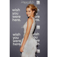 In Collette Dinnigan at the 2012 premiere of Wish you Were Here in Sydney. http://www.newsgab.com/attachments/celebrity-pictures/465858d1332341054-teresa-palmer-wish-you-were-here-australian-premiere-gray-dress-teresa-palm