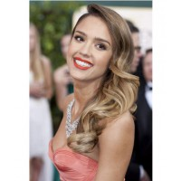 Jessica Alba's orange lipstick. http://www.blogher.com/jessica-albas-orange-lip-pops-red-carpet