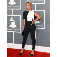 Look it's a neenish tart! Whoops, I mean Look it's the Queen of the Universe! Beyonce wears an Osman jumpsuit. Via hollywoodreporter.com