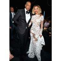 Beyonce always delivers. Looking beautiful in lacy Michael Costello. Image via http://www.huffingtonpost.com/2014/01/26/grammys-red-carpet-2014-photos_n_4628162.html