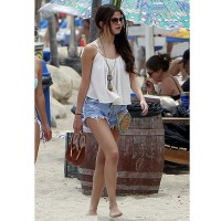 Selena Gomez chooses shorts for her beach to bar look http://www.dailymail.co.uk/tvshowbiz/article-2347052/Selena-Gomez-summer-siren-flowing-tiny-shorts-hits-beach-gal-pal.html credit: Pacific Coast News
