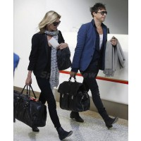 Kate Moss and Jamie Hince at the airport. source: Splash new online credit: Splash News http://www.splashnewsonline.com/2011-07-29/the-newlyweds-take-flight/spl298719_005-wm900-jpg/