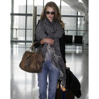 Rosie Huntingon-Whitely leopard print scarf in Heathrow Airport. source: gomoneyways.com credit: INF daily http://www.gomoneyways.com/?p=25580