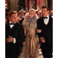 Leonardo DiCaprio, Carey Mulligan, and Tobey Maguire star as the leading trio. source: filmofilia.com credit: The Great Gatsby http://www.filmofilia.com/9-the-great-gatsby-hi-res-photos-129960/