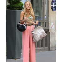 Blake Lively in high waisted pink palazzo pants on the Gossip Girl set. source: sugarscape credit:Wenn http://www.sugarscape.com/main-topics/fashion-beauty/532235/blake-lively-and-leighton-meester-take-paris