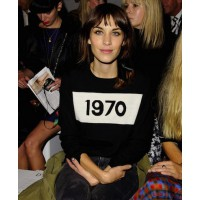 Alexa Chung in a Bella Freud sweater, front row at Simone Rocha, LFW source: Elleuk.com credit: REX http://www.elleuk.com/fashion/what-to-wear/slogan-sweaters#image=2