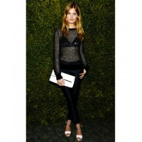 French model Constance Jablonski in a stunning sheer top source: whowhatwear.com credit: Getty Images http://www.whowhatwear.com/sheer-tops-black-bras/8