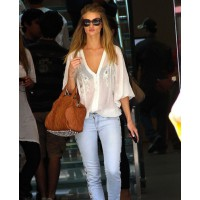 Rosie Huntington-Whitely rocks a white sheer blouse source: Glamour magazine UK credit: WENN http://www.glamourmagazine.co.uk/dos-and-donts/style-and-fashion/2010/06/14/rosie-huntingdon-whiteley-carries-an-alexander-wang-bag