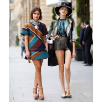 Miroslava Duma and Elena Perminova in Paris for the Fall 2012 shows. source: www.harpersbazaar.com credit: Mr Newton http://www.harpersbazaar.com/fashion/fashion-articles/street-style-couture-fall-2012#slide-1
