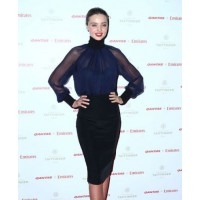 Miranda Kerr at the Qantas uniform debut night http://www.glamour.com/fashion/blogs/dressed/2013/04/how-to-channel-the-sexy-secret.html source: glamour online credit: Getty images