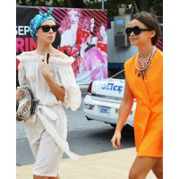 Miroslava Duma and Vika Gazinskaya source: www.bangstyle.com credit: Tommy Ton http://www.bangstyle.com/2011/10/its-all-about-tangerine/miroslava-duma-orange-blazer-dress-tommy-ton-ss2012-new-york-fashion-week/