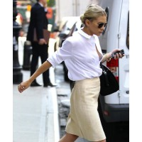 Ashley Olsen striding out in a crisp classic white shirt source: Shutupilovethatshirtonyou.blogspot credit: Olsens Anonymous http://1.bp.blogspot.com/-iVRAfw3jWvk/Tnf7EAK91SI/AAAAAAAABSY/GS0KiZ1JRg4/s1600/6155137620_2448687848_o.jpg