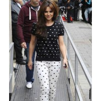 Cheryl Cole in clashing prints source: Now Daily online credit: Now Daily http://www.nowmagazine.co.uk/gallery/gallery-specials/35159/1/0/cheryl-cole-wears-clashing-prints-to-promote-new-album-a-million-lights-at-radio-1/1