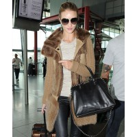 Rosie departing at Heathrow. source: I'm not obsessed online credit: WENN.com http://imnotobsessed.com/2011/09/21/rosie-huntington-whiteley-leaves-london/