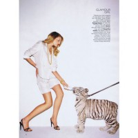 Lily Donaldson feeding a baby tiger, for Harper's Bazaar. Source: Terry Richardson for Harper's Bazaar