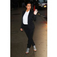 Kim Kardashian in a suit, image via http://radaronline.com/exclusives/2013/01/best-worst-wackiest-dressed-stars-of-week-photos/