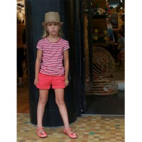 Sunny Perelberg, 6, wears Little Horn shorts and t-shirt, Camper Shoes, Emma Peel hat. Photographer Justin Perelberg.