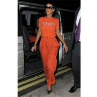 Rocking her newly cropped hair in casual Vintage 90's 'Kenzo' brand T-shirt (photo source: http://www.entertainmentwise.com/style/87417/1/Rihanna-Rocks-Pixie-Crop-With-Vibrant-Vintage-Style-And-Slams-Piers-Morgan)