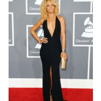 At the 2012 Grammy awards Giorgio Armani dress, Neil Lane cuffs, Jacqui Aiche body necklace, Christian Louboutin shoes and Jimmy Choo clutch (photo source: http://www.justjared.com/2012/02/12/rihanna-grammy-awards-2012/)