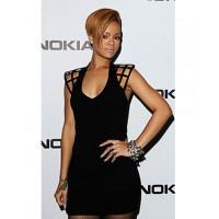 Rihanna in Junya Watanabe. http://audreymagazine.com/wp-content/uploads/2011/05/rihanna-funktional.jpg