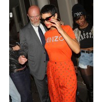 Rihanna rocks orange palazzo pants at a club in London source: Zimbio credit:Olga Bermejo, FilmMagic/Getty Images http://www.zimbio.com/photos/Rihanna/Celebs+Leave+Arts+Club+London/Tq2TNskFsmc