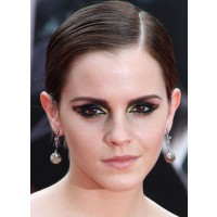 Emma Watson takes it all the way with this glittered smokey look. For very special occasions only! Image via http://makeupforlife.net/2011/08/makeup-tutorial-how-to-recreate-emma-watsons-dramatic-gold-and-black-cat-eye.html