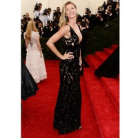 Gisele Bundchen looked a vision in Balenciaga - http://www.whowhatwear.com/met-gala-ball-red-carpet-fashion-2014/slide9