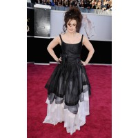 Helena Bonham Carter never fails to please. She's got that crazy-like-a-bat-shit-crazy-mo-fo-fox thing utterly cornered. Excellent bed head too.